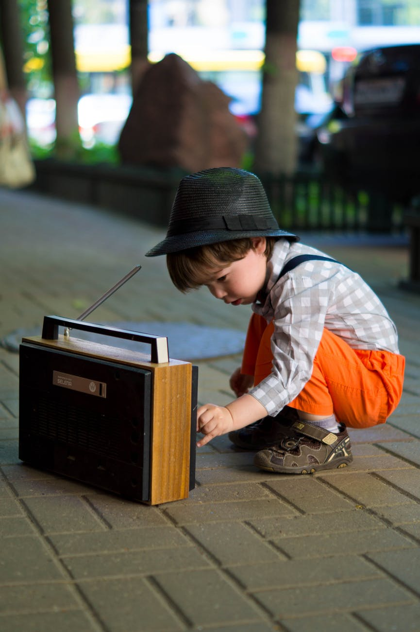 Child looking a radio