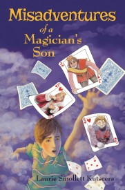 boy chasing playing cards flying away