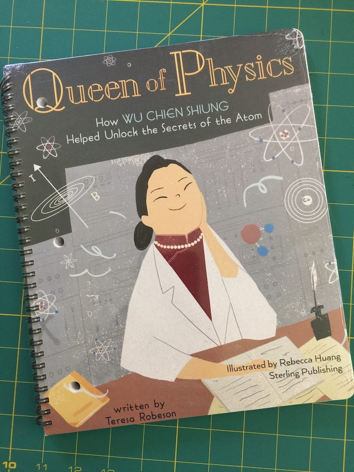 notebook with queen of physics on the cover